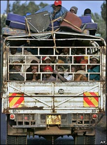 A truck transporting displaced Kenyans fleeing the city drives out of Nakuru 26/1/08