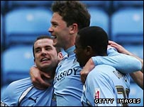 Stephen Hughes (centre) celebrates after scoring Coventry's opening goal