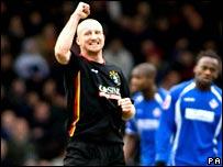 Luke Beckett celebrates his goal for Oldham