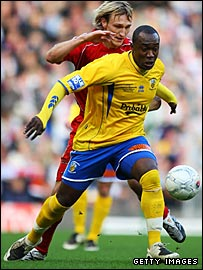 Liverpool's Sami Hyypia tussles with Havant goalscorer Richard Pacquette