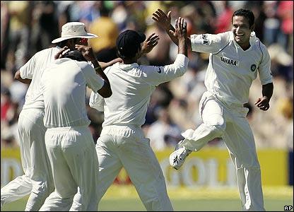 Irfan Pathan celebrates taking the wicket of Brett Lee