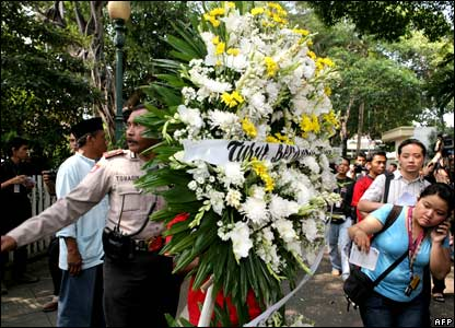 A policeman carries a wreath at the residence of the late president Suharto in Jakarta