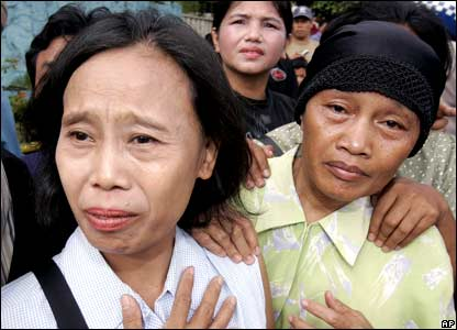 Indonesians cry as they gather outside a Hospital in Jakarta