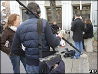 Journalists wait outside the police premises where Mr Kerviel is being questioned