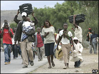 Residents of Naivasha, Kenya, flee the fighting on Sunday