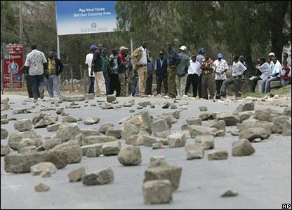 Men at a roadblock in Naivasha, about 70km north of Nairobi
