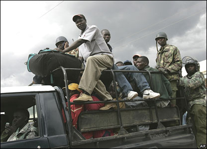 Police escort a group of Naivasha residents as they flee on Sunday