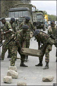Kenyan soldiers remove a roadblock in Naivasha, Kenya, on Sunday