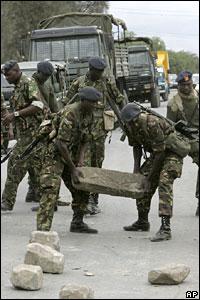 Kenyan soldiers remove a roadblock in Naivasha, Kenya, on Sunday