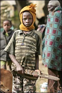 A Kikuyu boy holds a machete as residents arm themselves following an earlier raid on his village, Mutakaniob, near Nakuru, in Kenya on Sunday