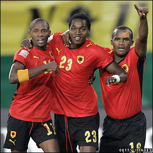 Angola's players celebrate their equaliser