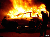 Lebanese protestors burn a car in the mainly-Shiite southern suburbs of Beirut, 27 January 2008.