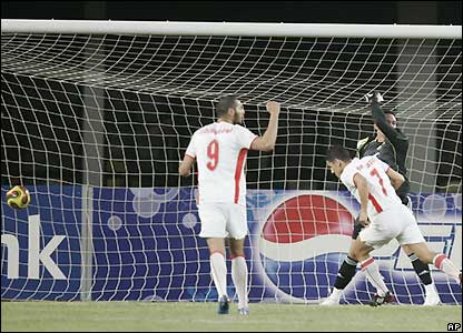 Chaouki Ben Saada scores the second for Tunisia