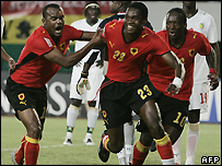 Manucho (centre) celebrates after scoring a brace against Senegal