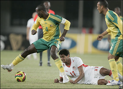 Mokoena takes the ball off Issam Jemaa