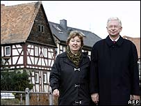 Roland Koch and his wife go to their polling station in Eschborn, Hesse