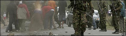 Kenyan army patrol a street during ethnic clashes in Naivasha