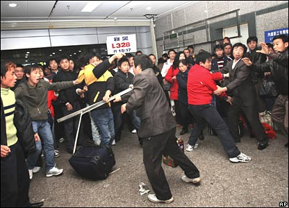 Passengers fight at a train station in southern China