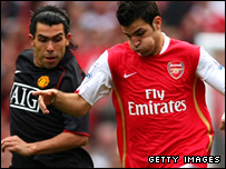 Carlos Tevez and Cesc Fabregas in action
