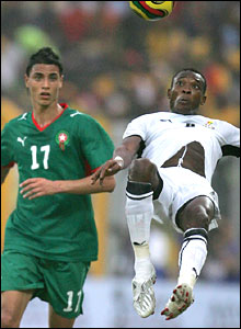 "Ghana""s John Pantsil fights for the ball with Morocco""s Marouane Chemakh"