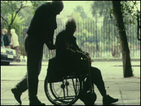 A carer and a man in a wheelchair