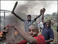 Luos search passing vehicles for Kikuyus at a makeshift roadblock in Kisumu