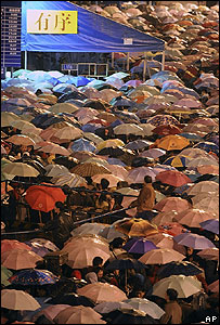 Crowds wait in the rain outside Guangzhou rail station