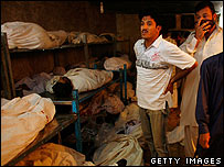 Family member identify the dead at an Edhi morgue after a suicide bombing in Karachi in October