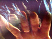 Hand being viewed through 3d screen and polaroid filter