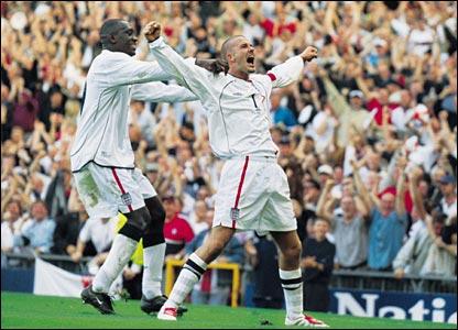 David Beckham celebrates after scoring against Greece