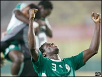 Nigeria players, with Taye Taiwo in the foreground, celebrate their qualification