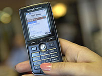 Texting BBC News on a mobile phone