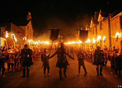 Street procession by torch light