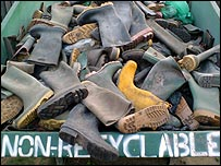 Abandoned festival wellies in a skip on the farm