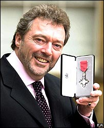 Jeremy Beadle with his MBE