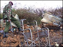 Soldier sifts through ruins of the church burning that killed Anthony's father