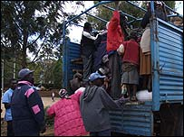 Kikuyus clamber onto a truck leaving Eldoret