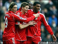 Liverpool players celebrate - from left, Torres, Gerard, Babel