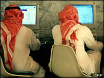 Saudi Arabian men browse the internet