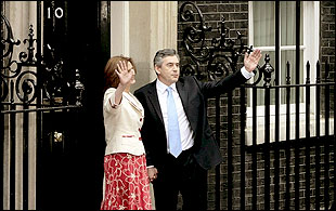 Gordon Brown and his wife Sarah arrive at number 10 Downing Street for the first time, 27 June 2007