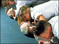 Students practising artificial respiration on dummies