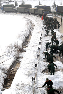 Police clear snow in China
