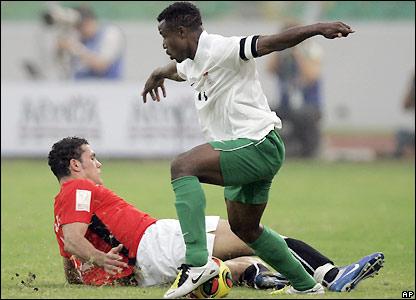 Zaki attempts to tackle Chris Katongo