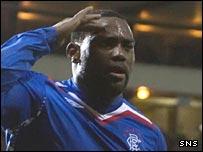 Jean-Claude Darcheville salutes the Rangers fans