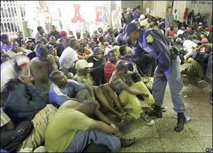 Police conduct a raid on the Central Methodist Church in central Johannesburg