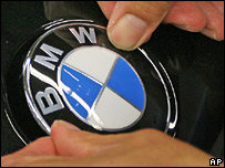 A worker fitting the BMW logo