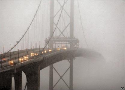 The Forth Road Bridge, west of Edinburgh, in heavy snow and fog