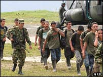 A group of demobilised Farc fighters disembark from a military helicopter on 23 January