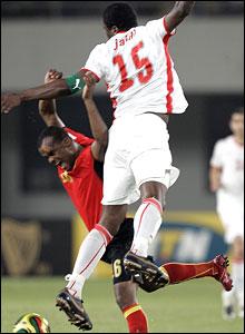 Angolan forward Flavio and Tunisia's Radhi Jaidi