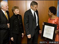 George Clooney (centre) with parents Nick and Nina Clooney (left) and  UN Deputy Secretary-General Asha-Rose Migiro